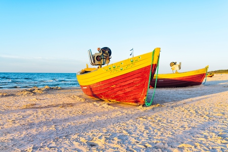 fishing boats on the sandy beach during sunset - Baltic Sea Poland Фото со стока
