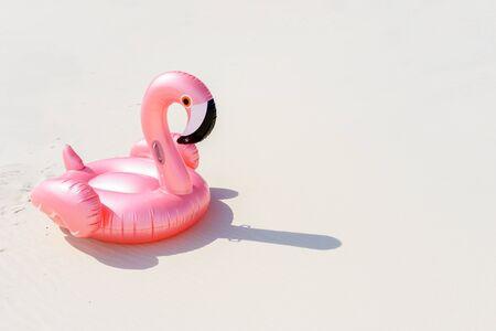 pink flamingo on a sandy sea beach Фото со стока - 129408934