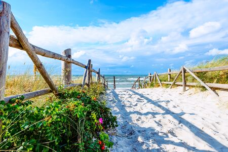 Entrance to beautiful sandy beach in Lubiatowo coastal village, Baltic Sea, Poland