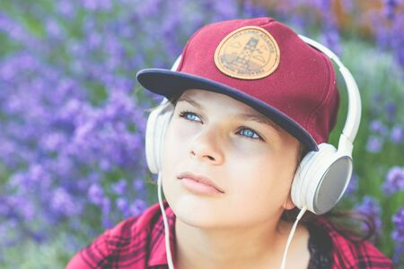Teenager listening to music with headphones outdoors