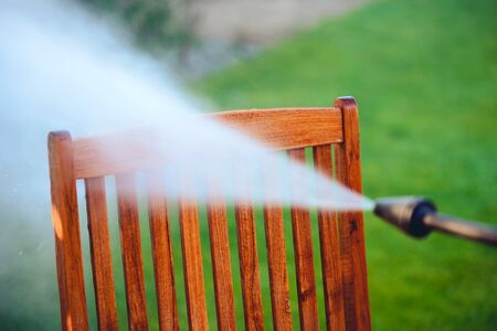 power washing garden furniture - made of exotic wood - very shallow depth of field