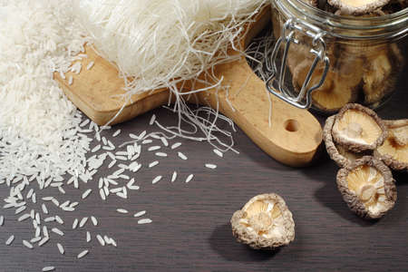 still life with shiitake mushrooms (Poku) (Lentinus edodes), rice nodles and rice grain photo