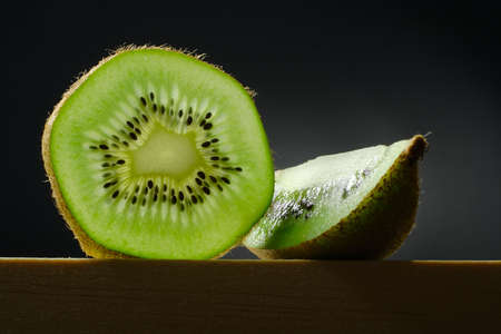 still life with slice and segment of kiwi fruit