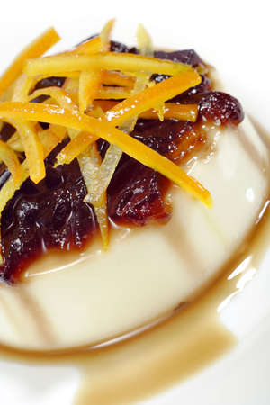 Vanilia pudding with gelled coffee sauce and orange peel photo