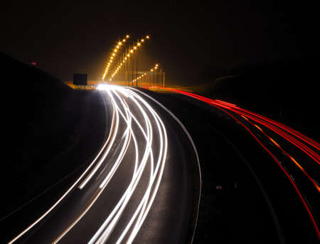Highway with car lights trails at night Stock Photo
