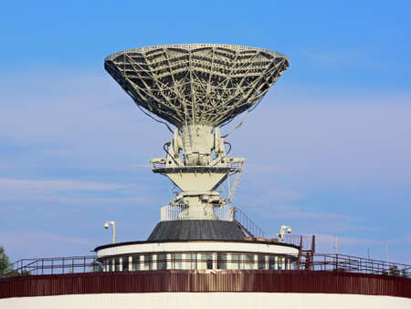 latticework: Telecommunication satellite antenna on top of building Stock Photo