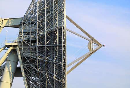 latticework: Big telecommunication satellite antenna detail with sky