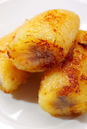 Close-up of baked caramelized bananas on plate Reklamní fotografie