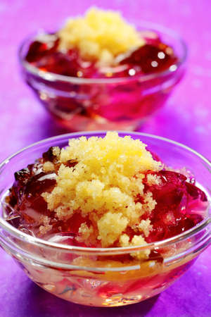 Assorted jellies in bowl with lemon sorbet. Second bowl on unfocused background. Stock Photo