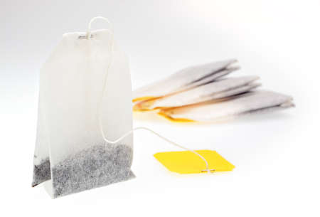 Tea bags with yellow label on light background Stock Photo - 14209475