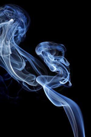 Abstract blue smoke isolated on black background photo