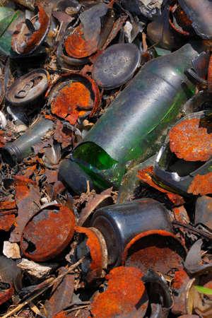 contaminate: Detail of garbage on the ground. Full frame shoot. Europe, Poland, Holy Cross Mountains.