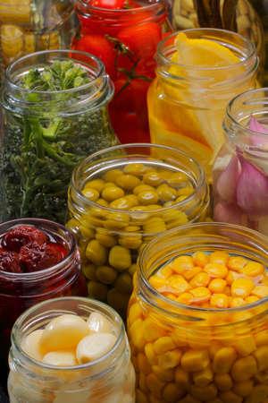pantry: Opened jars in pantry with various preserved food
