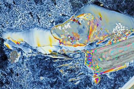 Microscopic view of a magnesium sulfate heptahydrate. Polarized light, crossed polarizers.