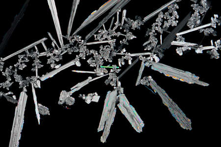 potassium: Microscopic view of a potassium nitrate (saltpeter) crystals. Polarized light, crossed polarizers.