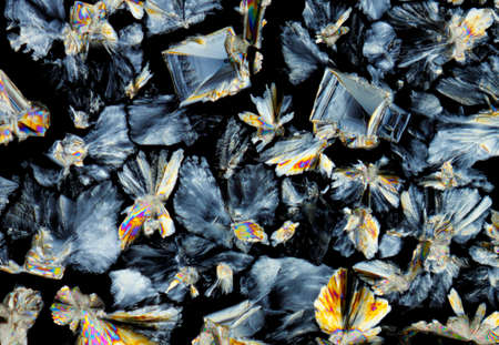 polarised: Microscopic view of a saccharose crystals. Polarized light, crossed polarizers.