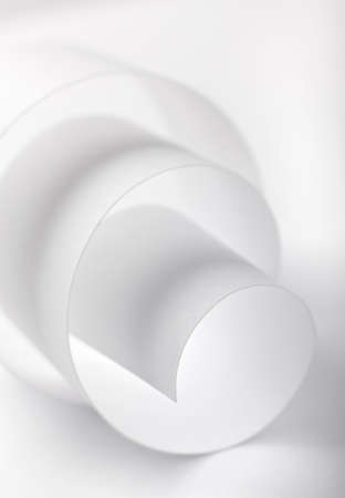 Rolled paper abstract. High-key lighting technique.