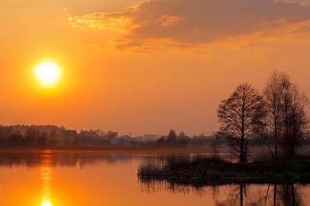 Warm sunset over lake. Poland, Holy Cross Mountains. Stock Photo