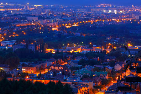 urbanized: Night shot of cityscape. Kielce, Poland, Holy Cross Mountains.