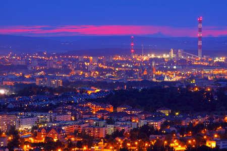 urbanized: Night shot of cityscape. Kielce, Poland, Holy Cross Mountains.
