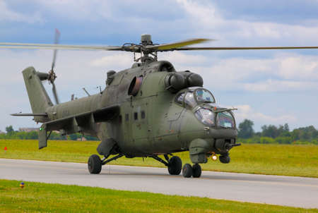 gunner: The Polish Air Force Mil Mi-24D Hind-D on runway during International Air Show at the 90th Jubilee of The Polish Air Force Academy The School of Eaglets. Deblin, Poland, 20th June 2015.