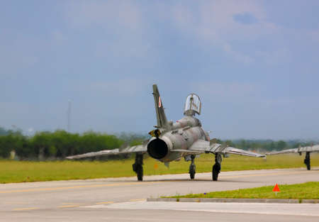 fitter: Rear view of the Polish Air Force Sukhoi Su-22M4 Fitter on runway during International Air Show at the 90th Jubilee of The Polish Air Force Academy The School of Eaglets. Deblin, Poland, 20th June 2015.