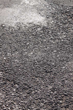 Aged coarse asphaltic road surface abstract texture close up Reklamní fotografie
