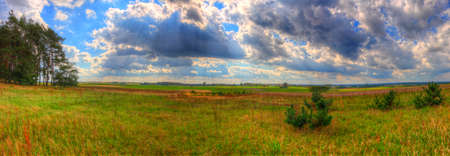 Landscape with meadow and trees under cloudy sky. HDR image. Poland, The Holy Cross Mountains. Reklamní fotografie - 120551161