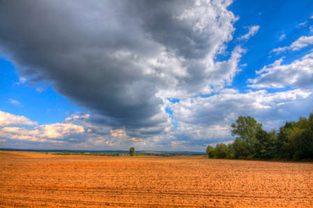 Ploughed field at late summer. HDR image. Poland, The Holy Cross Mountains. Reklamní fotografie - 120551166