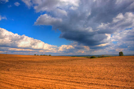 Ploughed field at late summer. HDR image. Poland, The Holy Cross Mountains. Reklamní fotografie - 120551168