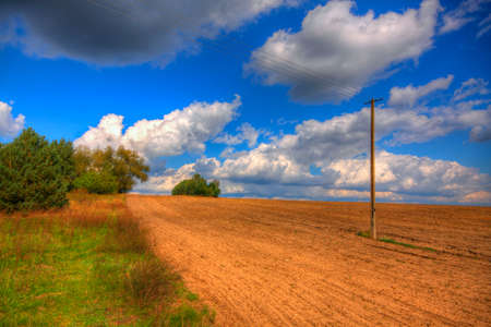 Ploughed field at late summer. HDR image. Poland, The Holy Cross Mountains. Reklamní fotografie - 120551164