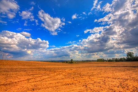 Ploughed field at late summer. HDR image. Poland, The Holy Cross Mountains. Reklamní fotografie - 120551167