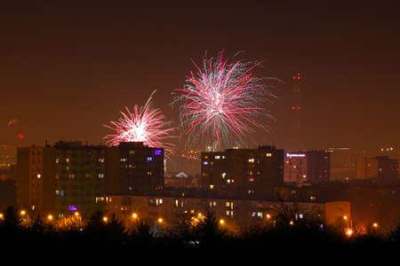 Night shot of a fireworks over city. Poland, Kielce, The Holy Cross Mountains. Reklamní fotografie - 120551169