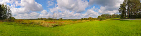 Panoramic landscape with meadows under cloudy sky. Poland, The Holy Cross Mountains. Reklamní fotografie - 120551170
