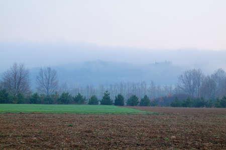 Foggy landscape with fields. Poland, The Holy Cross Mountains. Reklamní fotografie - 120542872