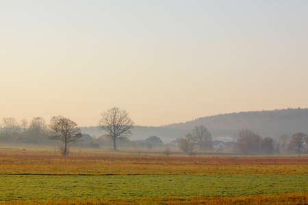 Hazy morning over meadows. Poland, The Holy Cross Mountains. Banco de Imagens