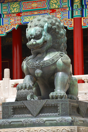 Bronze lion near the entrance to Emperor Temple in Forbidden City photo