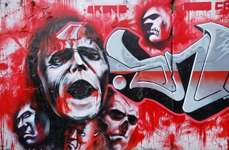 deface: abstract graffity on the wall as a background Editorial