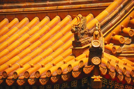 Beautiful yellow tile on the roof of chinese temple