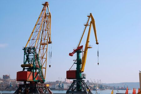 loading of cargo: Two big cranes in seaport loading cargo