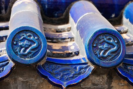 chinese ethnicity: Beautiful blue tile on the roof of chinese temple