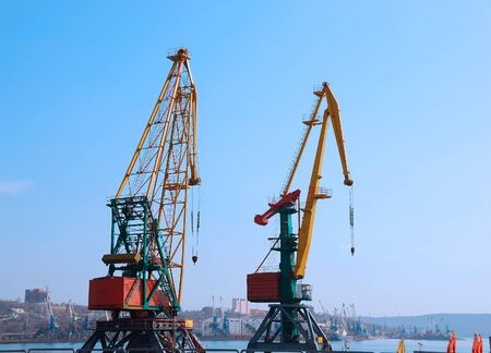 consignment: Crane loading cargo in the port Stock Photo