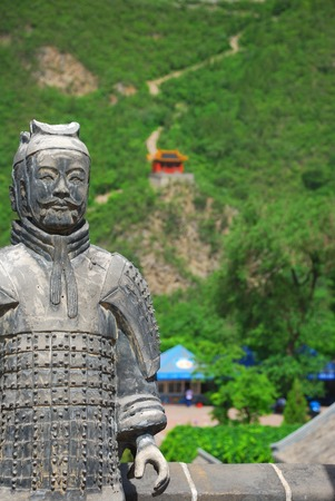 Old chinese stone warrior on the  Great Wall background