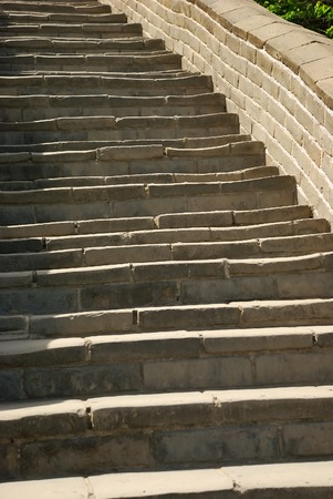 Old bricks stairs of Great Wall as a background Imagens