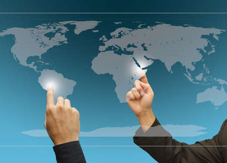 associates: Two business hands point to difference target on the world touch screen Stock Photo