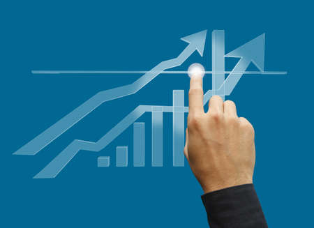 hand business touch point of the graph on screen Stock Photo - 10372626