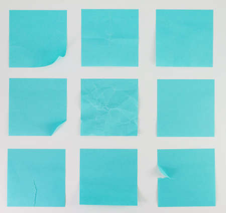 Blue Blank papers with curled corners  photo