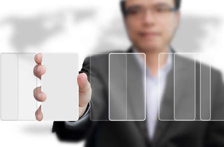 businessman hold the right virtual button for goal Stock Photo - 10373166