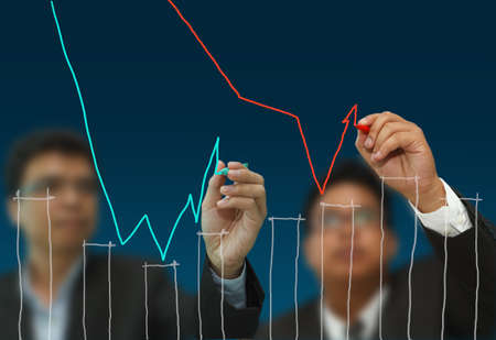 Two business men draw competition arrows and charts Stock Photo - 10372143