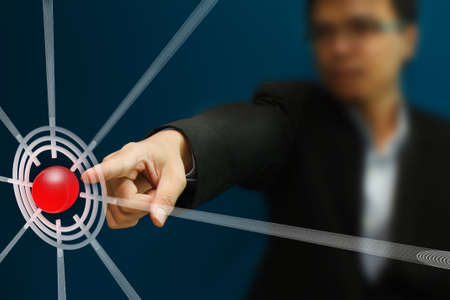 Business man pointing to the target on touch screen Stock Photo - 10371639